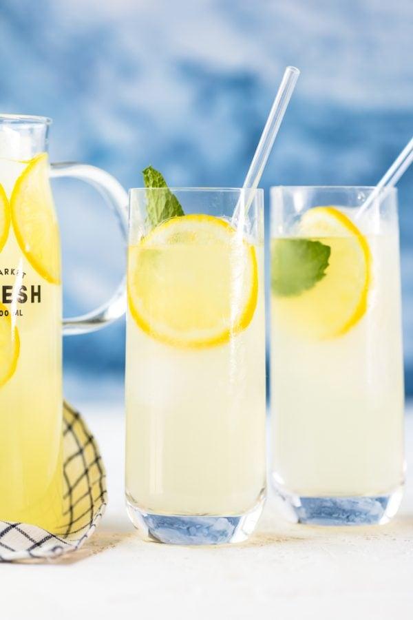 glasses of lemonade against a blue background