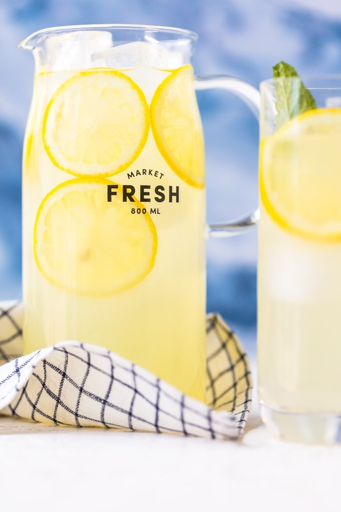 A pitcher of fresh squeezed lemonade with ice and lemon slices