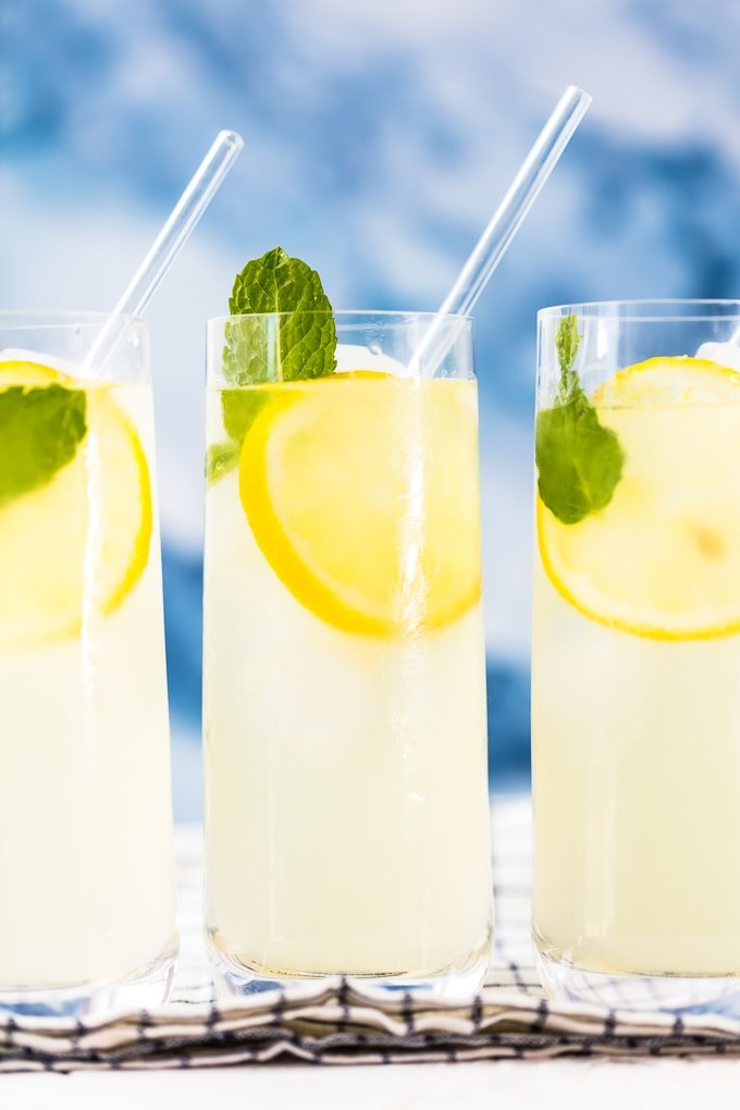 3 glasses of lemonade with straws
