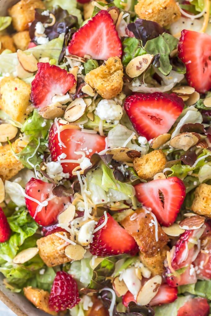 Fresh strawberry poppyseed salad dressed with homemade poppyseed dressing