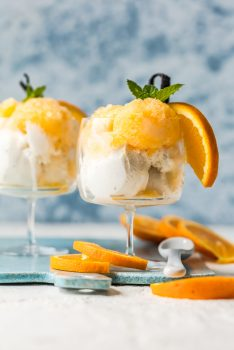 This Orange Cream Granita recipe is a fresh, fruity, icy dessert! Orange Creamsicle Granita is made fresh and served alongside ice cream for the perfect summer dessert.
