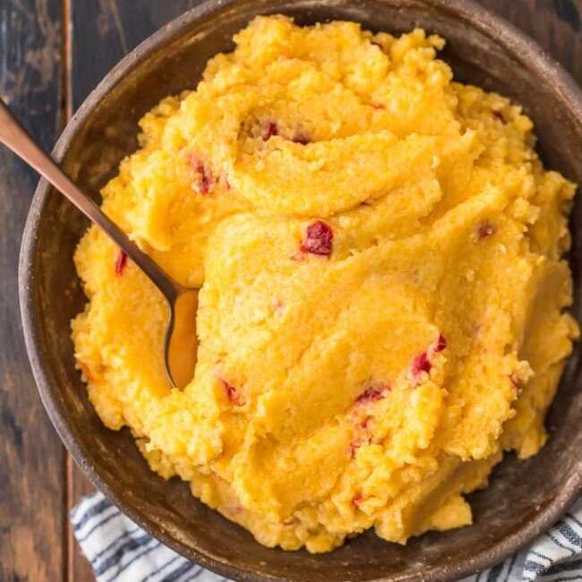 Cheese Grits are a classic Southern staple perfect for a quick breakfast, snack, or side dish. I combined them with another staple to create this delicious Pimento Cheese Grits recipe! They're cheesy, creamy, and oh so tasty. Eat them on their own on pair them with pork or chicken. You're going to love these easy cheese grits!