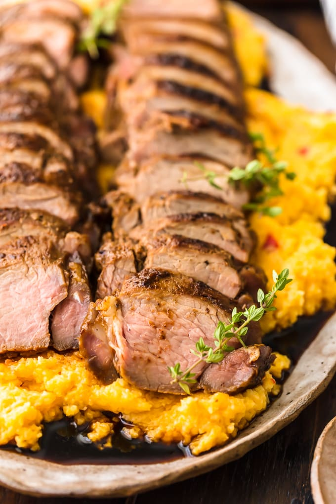 Pork tenderloin on a bed of pimento cheese grits