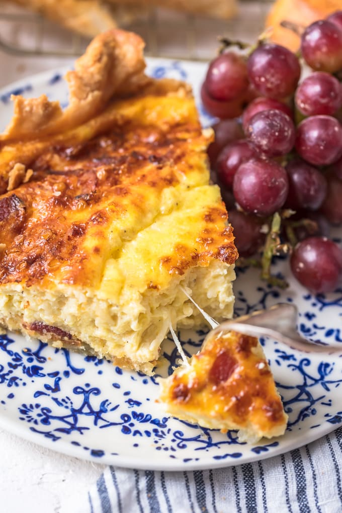 Cheesy quiche on a blue and white plate