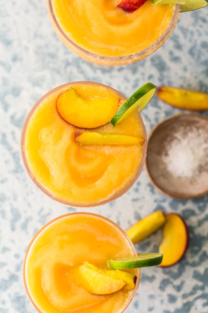 top view of peach margaritas in a glass
