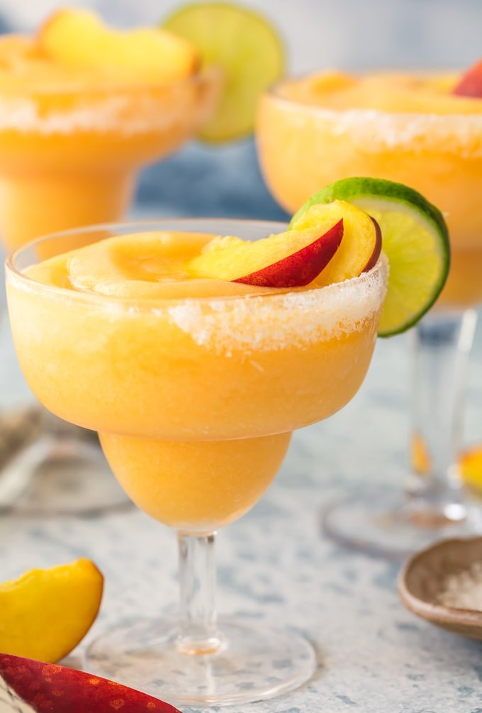 skinny frozen peach margaritas in glasses