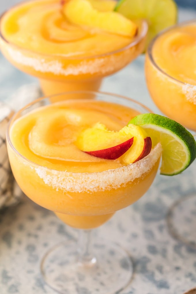peach frozen margaritas with salt and fruit