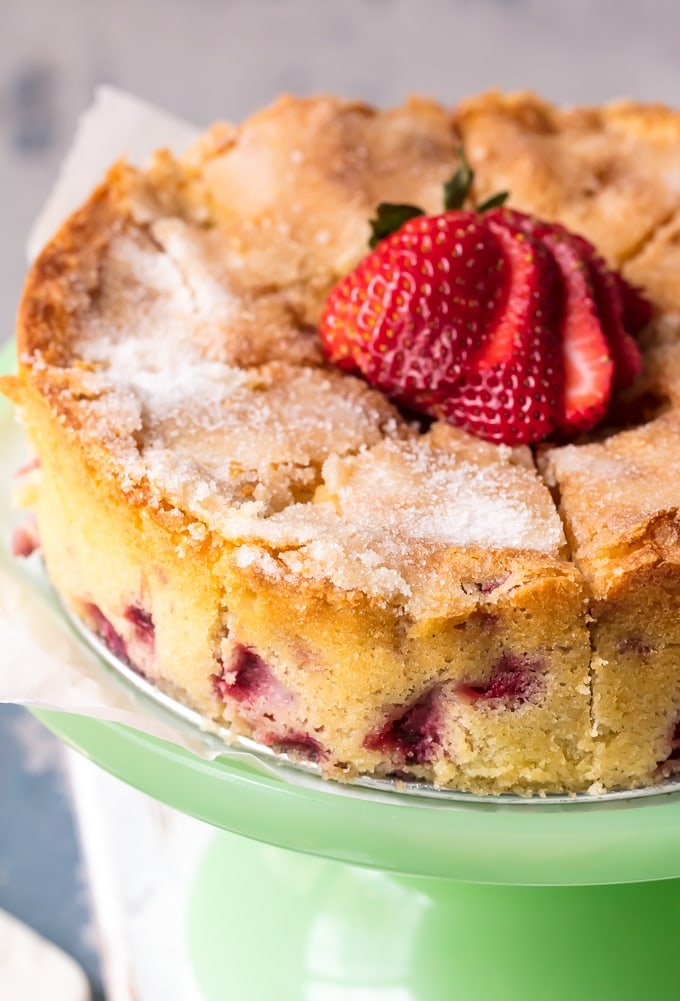 Strawberry Buttermilk Cake recipe topped with sugar and strawberries