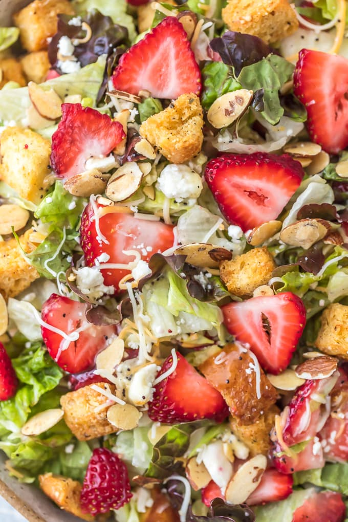 Lettuce, strawberries, feta, sliced almonds, croutons