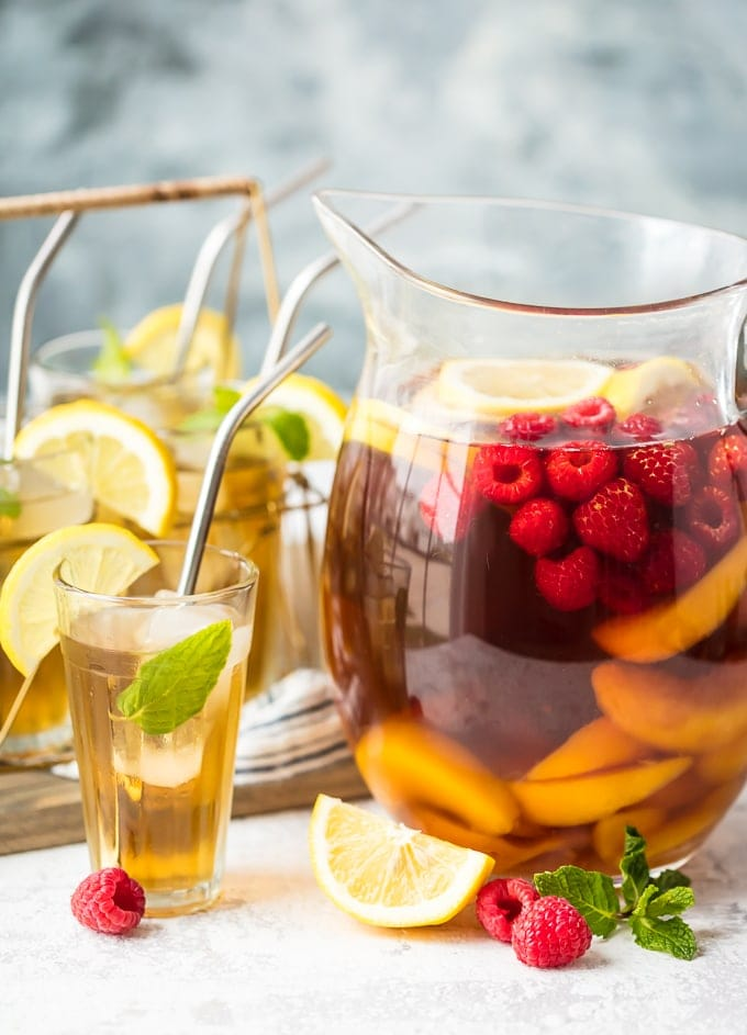 Sweet Tea Sangria in a pitcher, next to a glass of sangria
