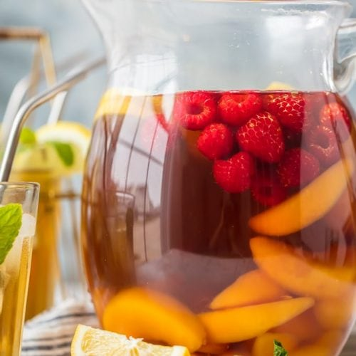 pticher of sweet tea sangria with sliced fruit