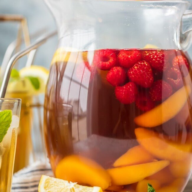 pticher of sweet tea sangria with sliced fruit