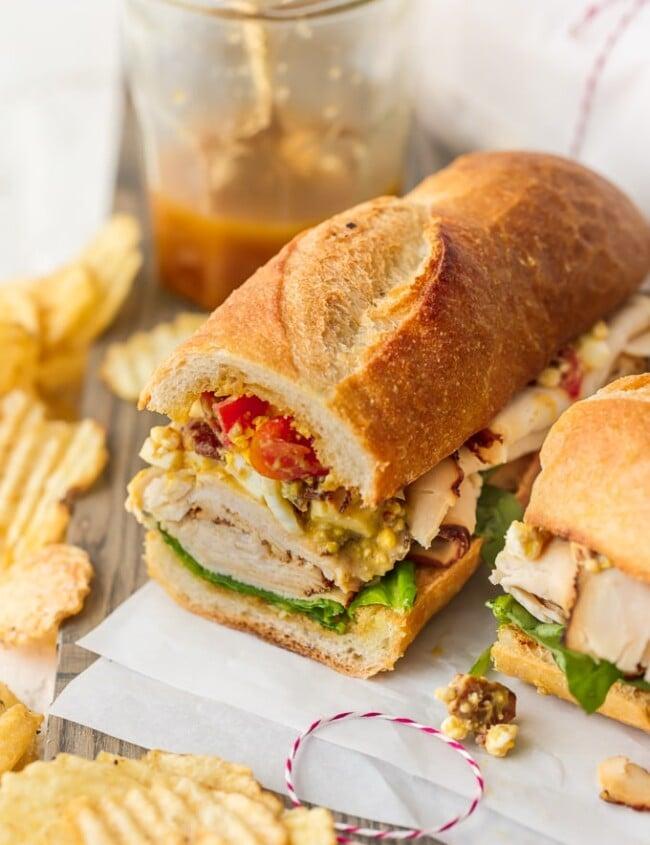 teriyaki chicken cobb salad sub sandwich on a platter