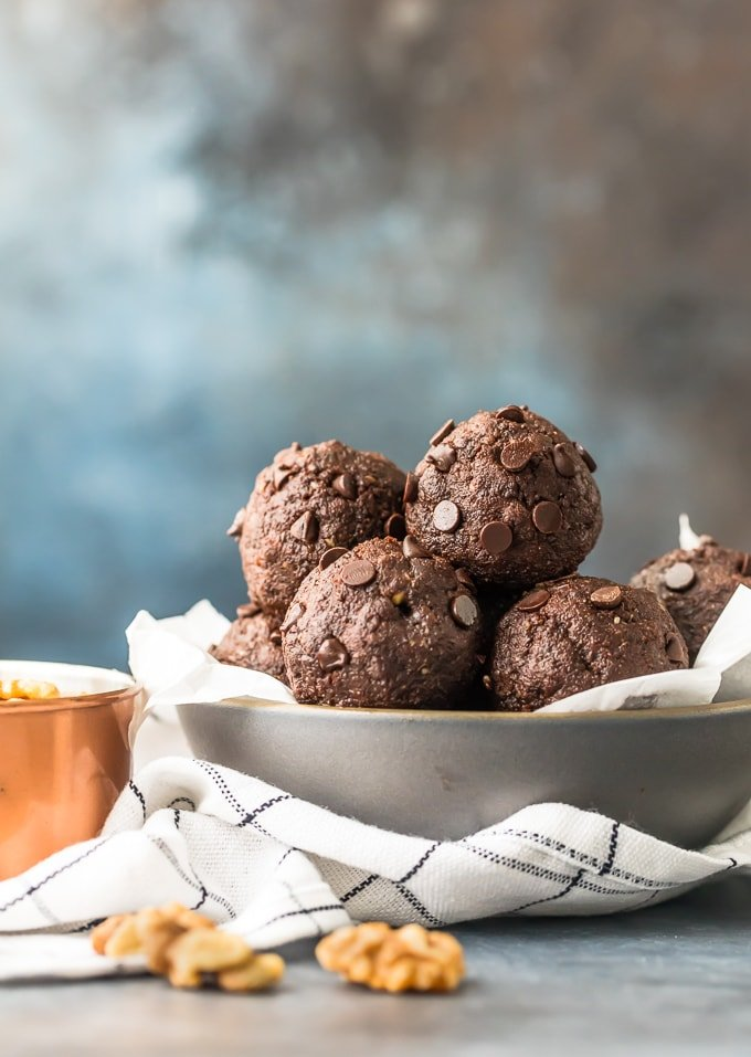 Walnut Brownie Protein Balls stacked in a bowl
