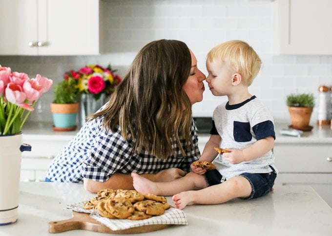 becky hardin with son on kitchen counter eating cookies