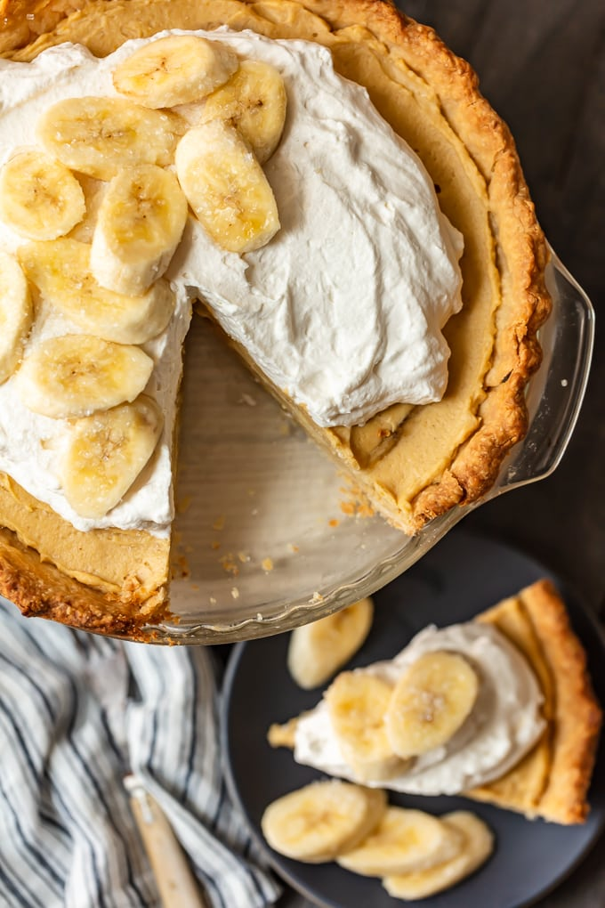 Banana cream pie with a single slice cut out