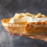 Banana Cream Pie is a creamy, delicious dessert filled with custard and fresh bananas. It's the perfect holiday recipe for Christmas, Easter, or Thanksgiving. This easy banana cream pie recipe is so rich and so tasty, everyone will love it!