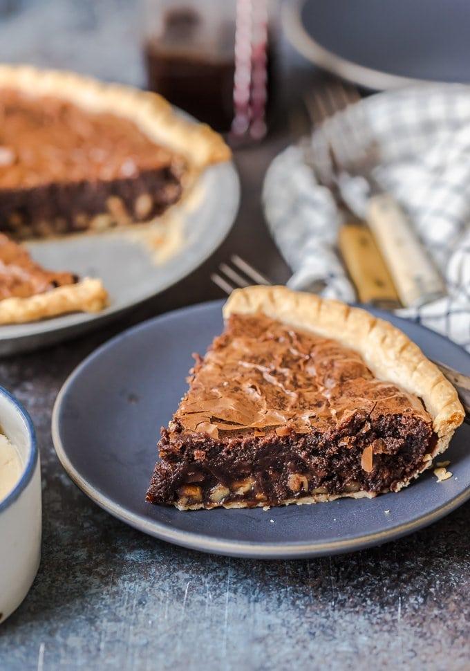 A slice of fudge brownie pie on a plate