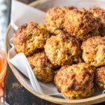This classic Sausage Balls recipe is savory, cheesy, and tasty! These Bisquick sausage balls are the perfect appetizer for holidays or game day. Serve them with apricot sweet chili dipping sauce!