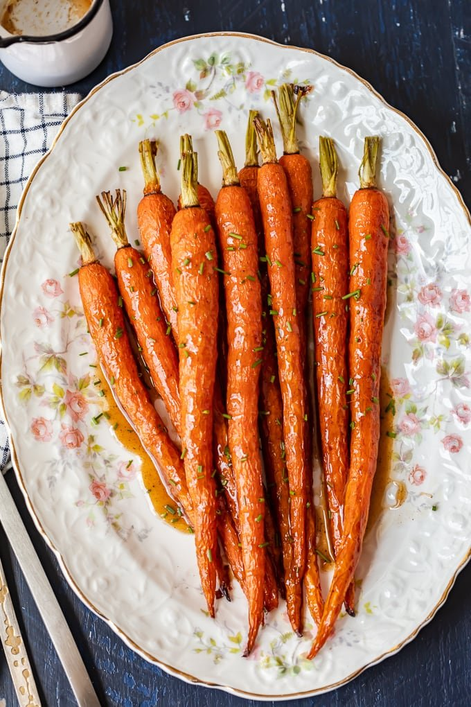 Whole roasted carrots covered in a honey ginger glaze