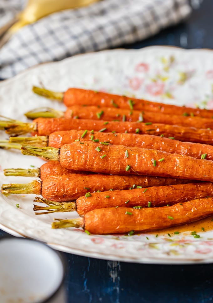 Glazed carrots on a serving plate sprinkled with chives