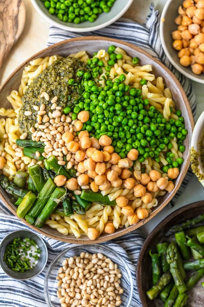 Green Goddess Pasta Salad is the stuff Summer Recipe dreams are made of! This healthy Pasta Salad Recipe is full of flavor and oh so easy to throw together. Loaded with asparagus, peas, chickpeas, pine nuts, and the ultimate green goddess dressing, this Green Goddess Pasta Salad Recipe is perfect as a side dish, main course, or even guilt-free late night snack.