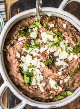 This homemade refried beans recipe is simple and absolutely delicious. Refried beans are the perfect side dish for your favorite Tex-Mex dishes, like tacos, cheesy chicken, nachos, burritos, & more!