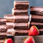 STRAWBERRY BROWNIES are perfect for Valentine's Day! This Chocolate Covered Strawberry Brownie Recipe is a mix of soft chocolate-y brownie, creamy strawberry filling, & a layer of melted chocolate.