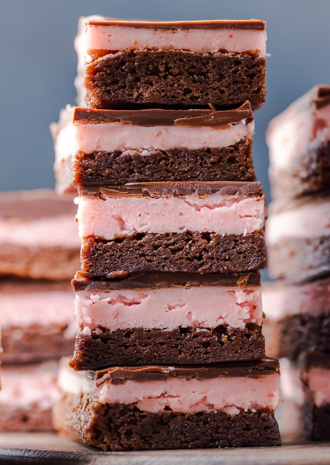 A stack of chocolate covered strawberry brownies