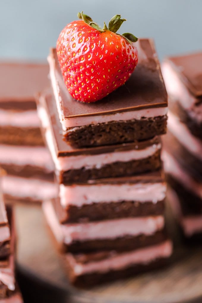 A stack of brownies with a strawberry on top