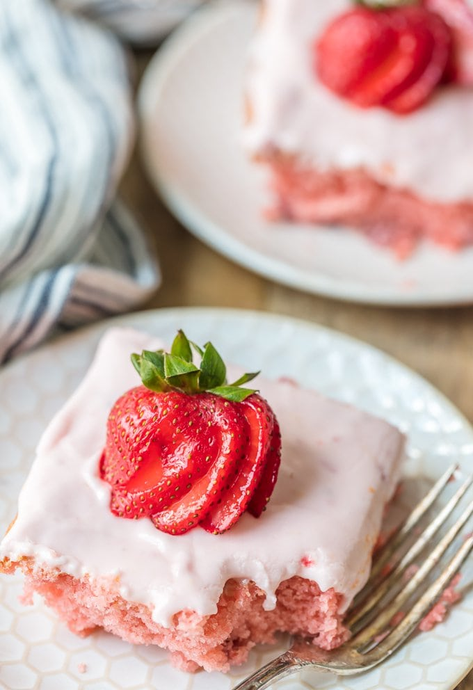 Homemade strawberry cake topped with fresh strawberries
