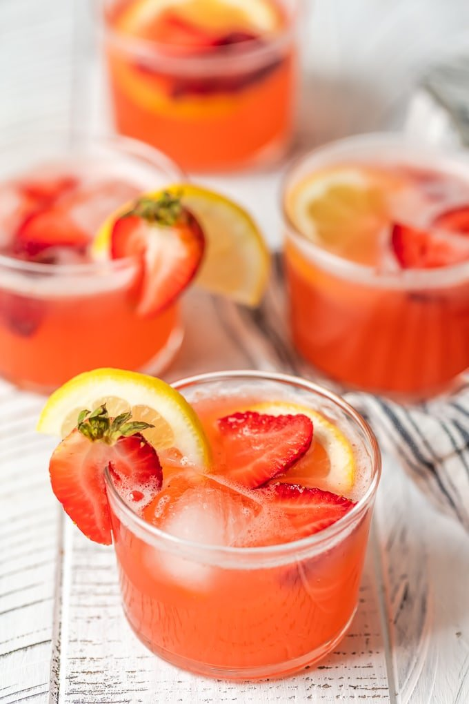 4 short glasses filled with strawberry lemonade party punch