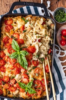 This Chicken Alfredo Pasta Bake is so cheesy, so creamy, and so full of flavor! I love this Chicken Alfredo Casserole for easy weeknight dinners. It's filled with chicken, cheese, tomatoes, pasta, and vegetables, and cooked in a creamy Alfredo sauce. I can't get enough of this Chicken Alfredo Bake!