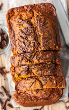 Pumpkin Chocolate Chip Bread is the perfect fall recipe. It's chocolatey, it's pumpkiny, and it's super delicious! This easy pumpkin bread recipe is simple enough to make any time you need a treat throughout the season, and it makes a fun holiday recipe too. This recipe for pumpkin bread with chocolate chips mixes everything I love about autumn!