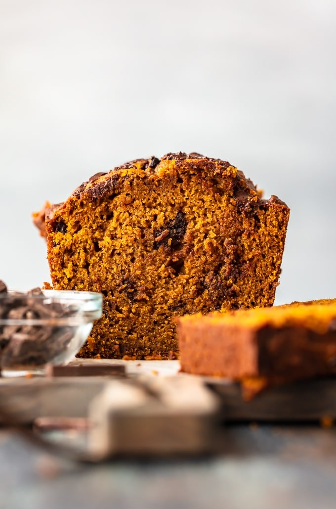 A loaf of pumpkin chocolate chip bread, viewed from the front