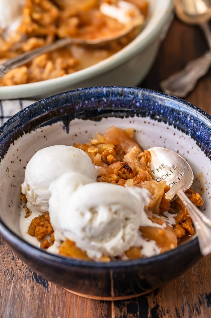 A bowl of homemade apple crisp topped with ice cream