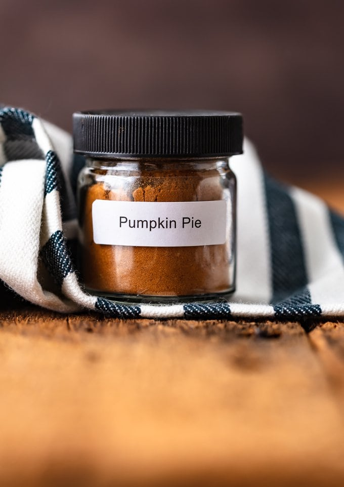Homemade Pumpkin Pie Spice in a small glass spice jar