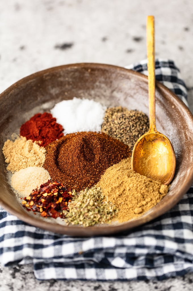 How to make taco seasoning: a bowl of oregano, paprika, chili powder, garlic powder, and other spices