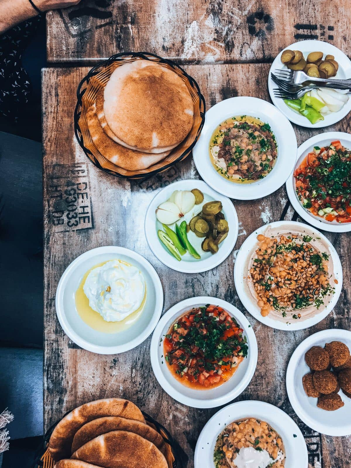 table of hummus, labna, and other dips in Israel