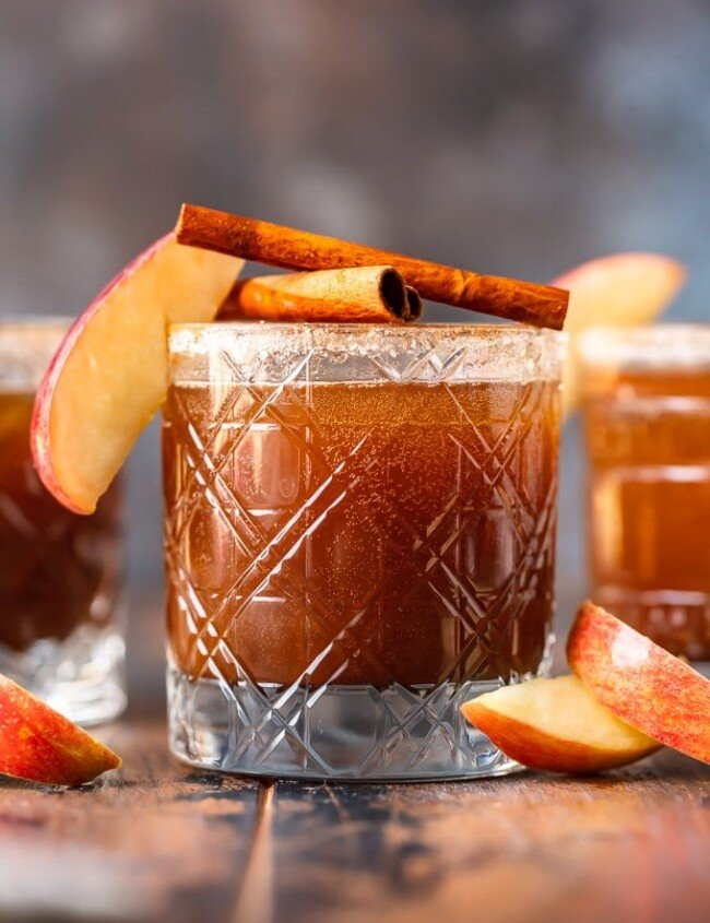 apple butter old fashioned in glass garnished with apple and cinnamon