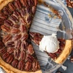 Chocolate Pecan Pie is the perfect mix of pecan and chocolate pies. Chocolate filling made with chocolate chips and bourbon, topped with toasted pecans. This Chocolate Bourbon Pecan Pie recipe needs to be added to your holiday dessert table as soon as possible. Make it for Thanksgiving, Christmas, or any time you wan this delicious pie!