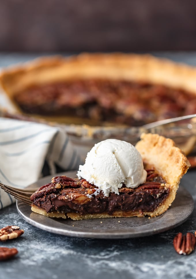 chocolate pecan pie topped with cream