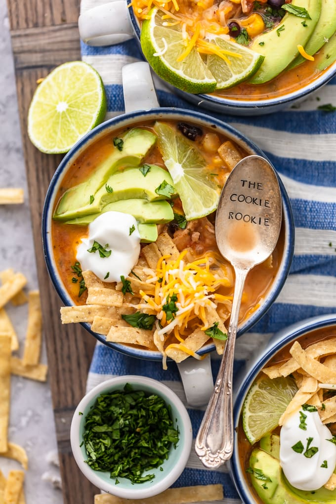 Bowls of chicken tortilla soup on a blue and white striped dish towel