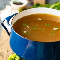 Homemade Chicken Broth is so easy to make, you won't need to buy it from the store anymore. This delicious chicken broth recipe is made with lots of vegetables, spices, and chicken to create the perfect flavor. Learn how to make chicken broth and use it in all of your soups this winter season!