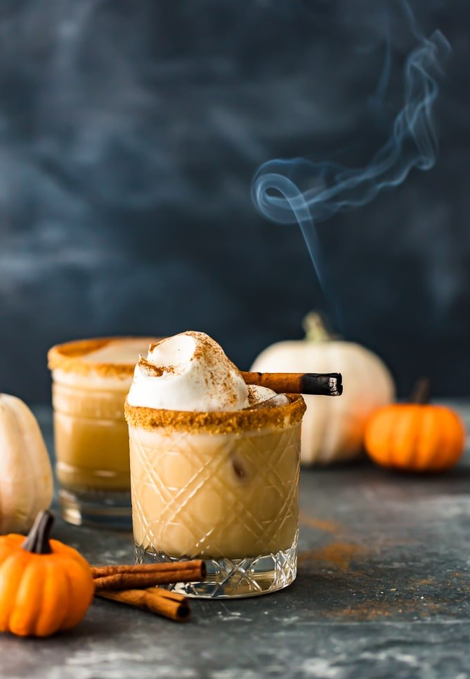 Pumpkin Spice White Russian Cocktail surrounded by mini pumpkins
