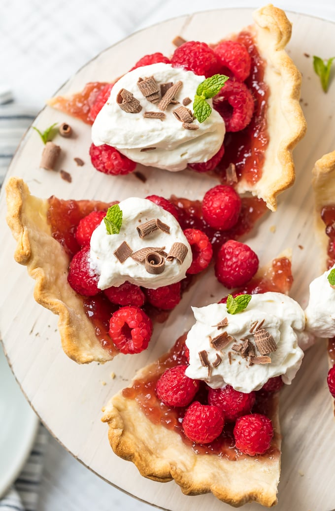 Raspberry tarts made with raspberry jam, fresh raspberries, and whipped topping