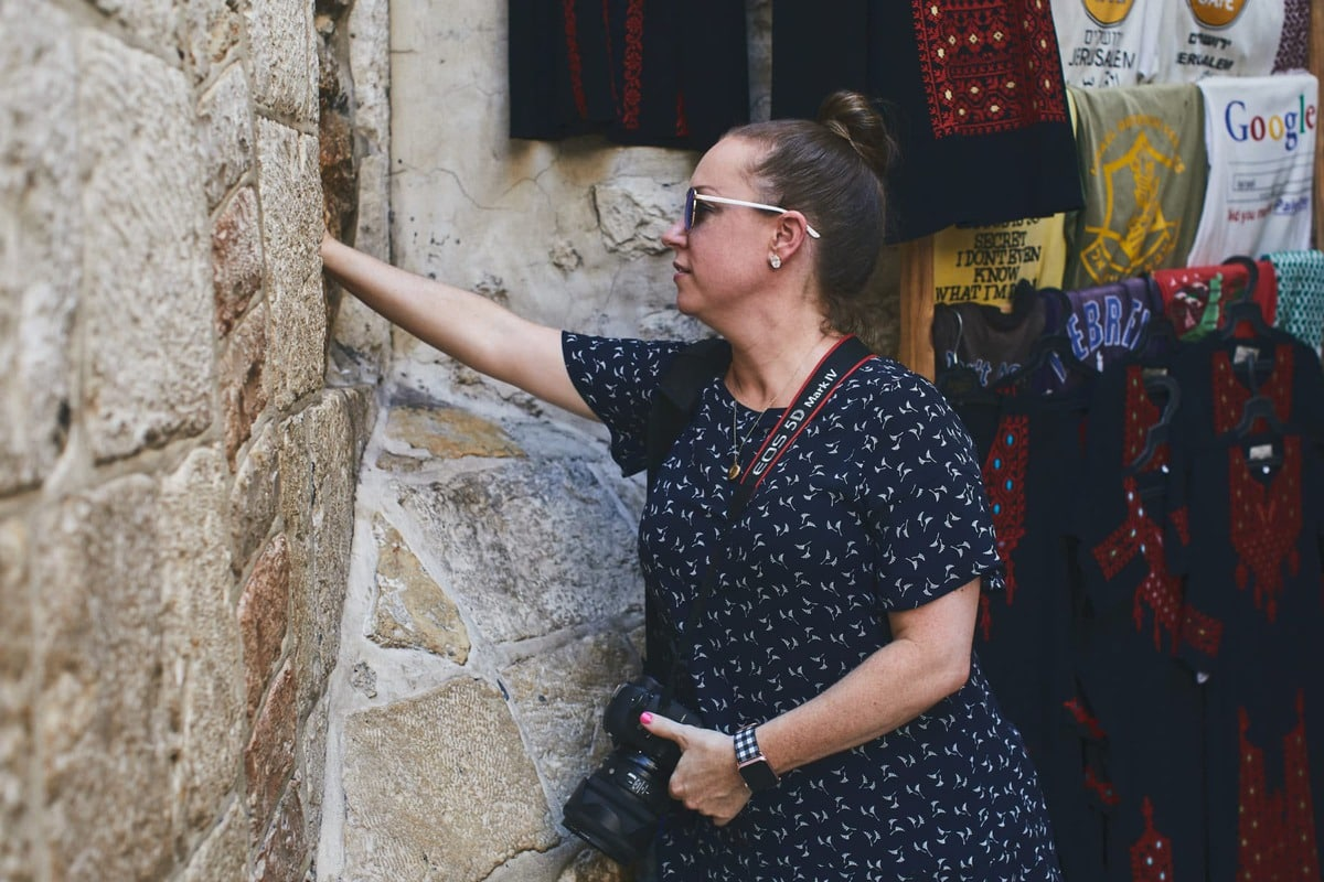 touching the wall at villa de la rosa in Jerusalem Israel
