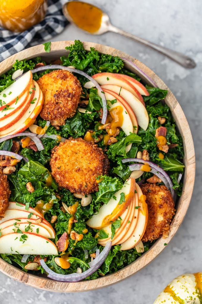 Kale Salad recipe with apples, onions, goat cheese, seeds, and bacon