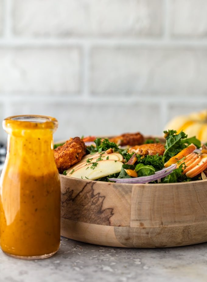 Maple Pumpkin Salad Dressing next to a bowl of Kale Salad
