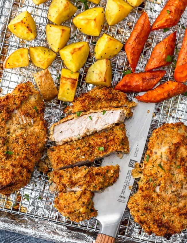 Breaded Pork Chops make an easy dinner for any night of the week. These breaded baked pork chops are crispy, flavorful, and beyond simple. Make your breadcrumbs, throw the pork chops in the oven, add some roasted veggies, and you've got one easy pork chop recipe made on a single sheet pan!